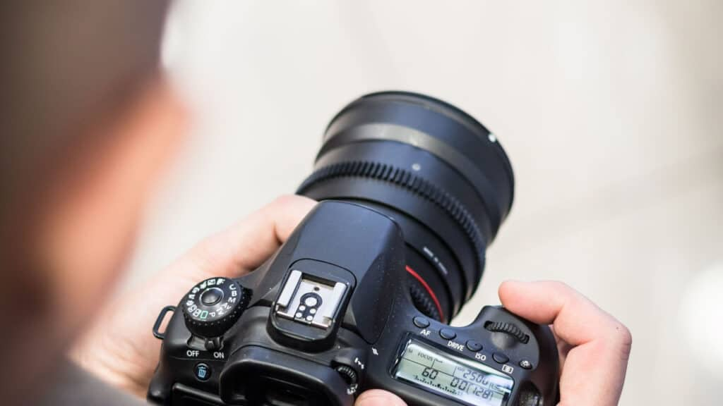 Image of a photographer holding camera