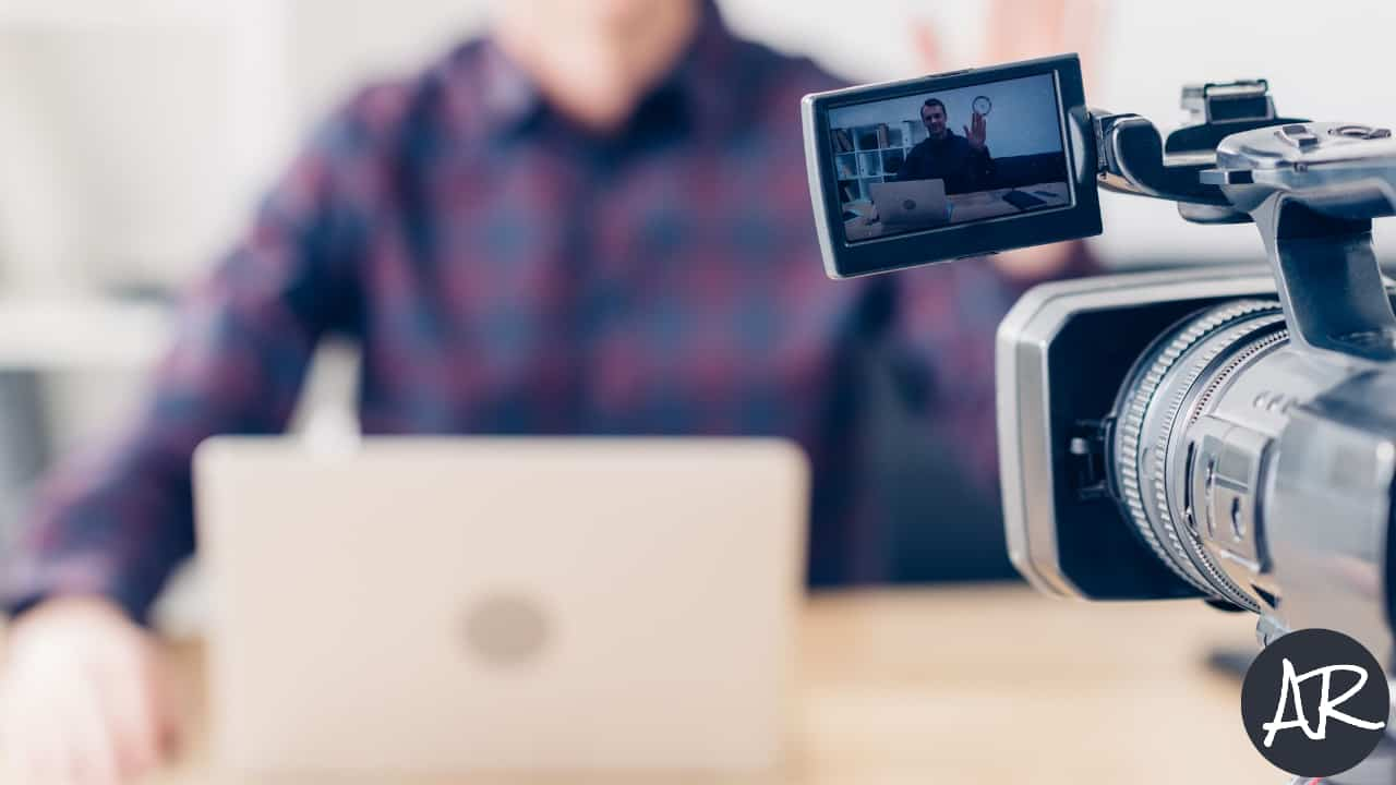 Image of a man recording a video
