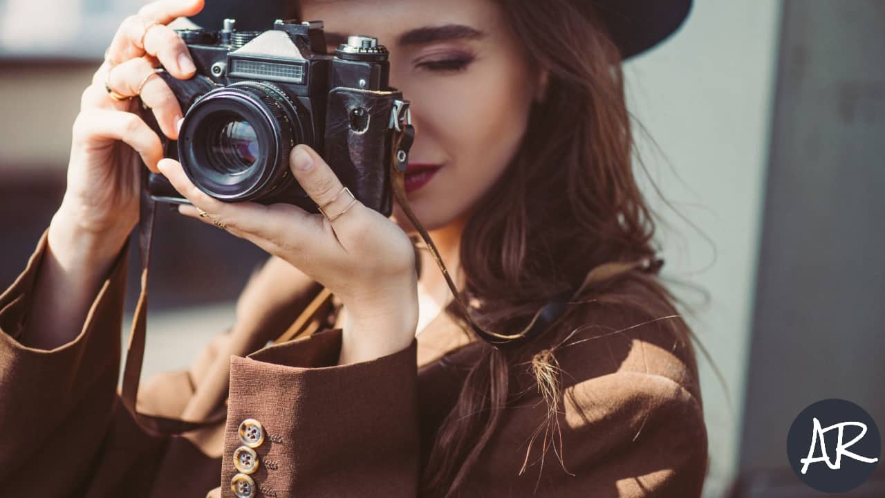 Image of a woman taking a photo